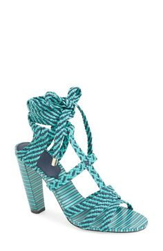 JIMMY CHOO. A two-tone woven upper complements the striped heel and sole of an ultrachic lace-up sandal with gleaming goldtone hardware accents. Made in Italy.
