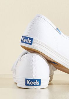 Skip the sky-high platforms, and kick your day off with the classic cool that can only come from these basic white Keds! A brilliant wear to bop around in with a floral skirt, a vintage band tee, and a fedora, these simple canvas sneaks lace your look up with a timeless touch of casual style!