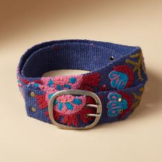 """TROPICAL FLOWERS BELT--Handmade by Peruvian artisans, our brightly embroidered webbed wool belt brightens winter days. Exclusive. Sizes S (32""""), M (34""""), L (36""""). 2""""W."""