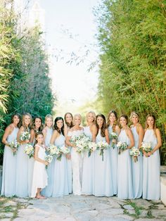 A bridal party of 12! http://www.stylemepretty.com/2017/04/10/lush-organic-wedding/ Photography: Lauren Kinsey - https://www.laurenkinsey.com/