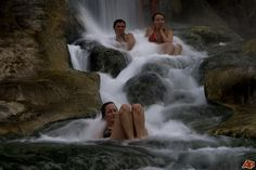 Bathers sit in rock pools among waterfalls in a medicinal baths complex at Thermopylae, central Greece