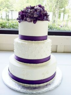lace instead of pearls.......Purple Round Wedding cake, idk about the flowers on top, but like the rest of the cake.