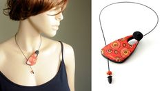 In the red hole necklace by P'tits Cailloux Creation.  Another clever use of a non-standard closure method.