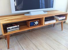 Mid century modern TV table/entertainment console featuring American cherry with tapered wood legs. Furniture Decor, Furniture Design, Living Spaces, Living Room, Mid Century Modern Furniture, Mid Century Design, Mid-century Modern, Family Room, New Homes