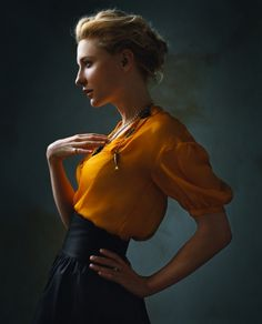 Saffron-colored silk blouse glows with it's own light against the black high-waisted skirt.