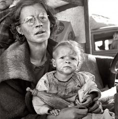 On the road with her family one month from South Dakota. Tulelake, Siskiyou County, Calif. September 1939. Photograph by Dorothea Lange.