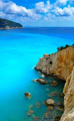 Porto Katsiki, Lefkada, Greece very famous and photogenic beach, it is at the bottom of an arc of pale cliff that seem to have the clean lines of something designed by an architect rather than a natural wonder Dream Vacations, Vacation Spots, Vacation Travel, Solo Travel, Places To Travel, Places To See, Travel Destinations, Wonderful Places, Beautiful Places