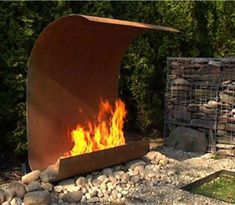 A cool contemporary garden fireplace manufactured of