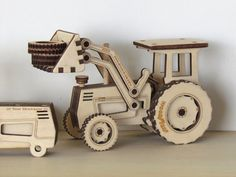 https://www.etsy.com/es/listing/116312717/madera-tractor-con-pala-gran-laser-corte?ref=market