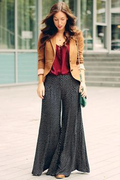 Plazzo pant with a brown jacket and red top.  A casual professional bohemian/retro style.