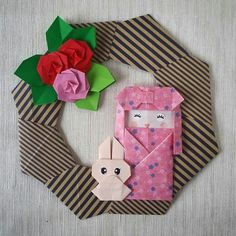 Origami wreath with kokeshi doll and little rabbit. Folded by Majomajo Video tutorial by Kamikey origami  https://youtu.be/GoY1H6hA2D4