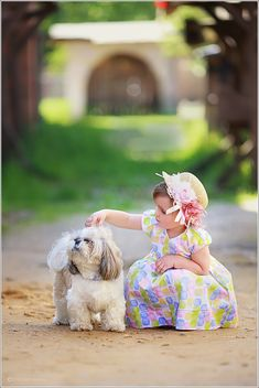 Cute girl and fluffy puppy