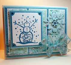 """Let It Snow"" card made with:    - Gina K Designs Merry Little Christmas stamp set  - Gina K Designs Pure Luxury 120 lb card stock (base)  - Gina K Designs Pure Luxury in Blue Raspberry (layer)  - Gina K Designs Blizzard patterned paper  - Memento ink in Teal Zeal    The stamp set is a part of the Merry Little Christmas StampTV kit. You can view the stamps and purchase the set in the StampTV Store by clicking on the image!"