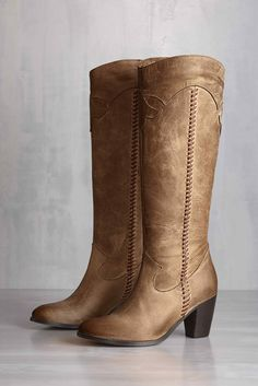 Tall boots with a western style from #johnstonmurphy.