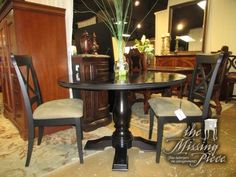 """Transitional style pedestal base dining table in a dark finish with two X-back chairs. The chairs are done in a dark finish with light, neutral seat cushions. Wonderful set for your dining room! 47""""round. Arrived: Tuesday November 15th, 2016"""