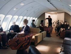 Upper lounge in a 1970's Boeing 747, the look of which is almost as awesome as the height of that beehive 'do.