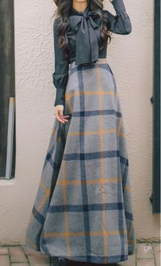A classy wool midi skirt with a mult color print, hidden side pockets and hidden back zipper available in S-XL.