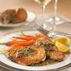 Turkey Cutlets Piccata - Sautéed turkey cutlets served with a zesty lemon and caper butter sauce, garnished with crisp-fried prosciutto strips.