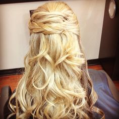 Can't decide whether to wear your hair up or down? Opt for the best of both worlds with this half up, half down homecoming hairstyle that we love, love, love!