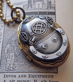 Items similar to Steampunk Locket Necklace Diving Bell Helmet Mixed Metals Small Vintage Brass Oval Shape Pewter Tone Finish Nautical Mask on Etsy
