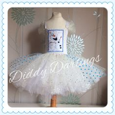 Olaf Tutu Dress. Sparkly Olaf Dress. Frozen Tutu Dress. Christmas Dress. Party Dress. Princess Tutu Dress. Xmas Dress. Glitter. Costume.  Beautiful & lovingly handmade.  Price varies on size, starting from £25.  Please message us for more info.  Find us on Facebook www.facebook.com/DiddyDarlings1 or our website www.diddydarlings.co.uk