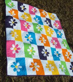 Crib or lap quilt featuring appliqued flowers by PiecesOfCotton 50x60.  $150