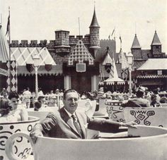 Walt Disney at the Teacup Attraction; Disneyland's opening day; July 17, 1955