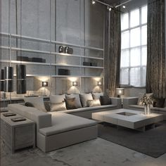 .dramatic white loft living room  White and metal bookcase with metal extending to the ceiling. Square, low coffee table