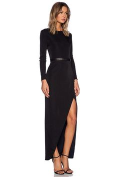 """""""The edginess and minimalism is what I love most about this dress. Rock some red lips and a cocktail ring to complete the look."""" — Sheryl Luke, Walk In Wonderland"""