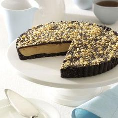 Peanut Butter Chocolate Tart Recipe -I've been submitted recipes for years to Taste of Home recipe contest, but never dreamed that I would win. I love peanut butter and add it to many of the desserts I make. This is one of my best and anyone who loves peanut butter cups will be in heaven when they take a bite of this rich, sensational tart. While it looks spectacular, it is very easy to put together.—Mary Ann Lee, Clifton Park, New York