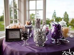 "Purple and silver candy buffet. Include small sign that says, ""Thank you for sharing sweet memories with us on our wedding day."""