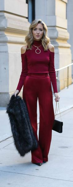 burgundy red satin wide leg pants, burgundy red ribbed knit cold shoulder mock neck sweater, charcoal grey faux fur vest, geometric circle gold statement necklace