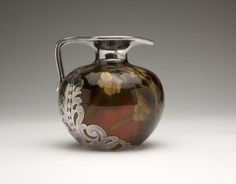 A Rookwood Jug With Sterling Silver Overlay