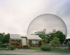 "Montreal 1967 World's Fair, ""Man and His World,"" Buckminster Fuller's Geodesic Dome With Solar Experimental House, 2012. Photo © Jade Doskow - Photography: When World Fairs End / Jade Doskow"