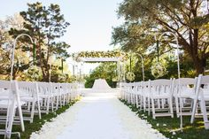 Four Seasons Austin Wedding Outdoor Wedding Ceremony White Decor Rose Pedals Wedding Aisle | Pearl Events Austin | Jake Holt Photography | Bouquets of Austin | Townsley Design | Four Seasons Austin |