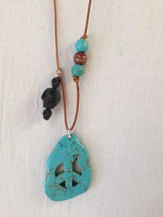 Turquoise Carved Peace sign necklace on Etsy, $175.00