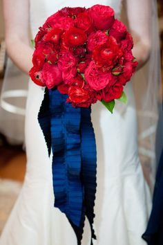 red garden roses with a pleated navy silk ribbon