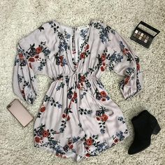 You can never have too many rompers! This light pink romper is decorated with a floral pattern. It has a deep v-neck and ties at the waist. The sleeves are 3/4 length and are elastic at the hem to giv