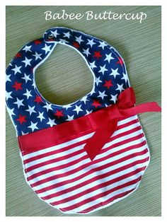 This adorable red, white and blue, stars and stripes baby bib is perfect for your precious little one to wear on the 4th of July. It is backed