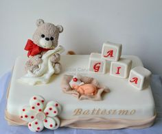 Sleeping baby with baby blocks and teddy bear