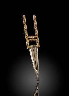 Punch Dagger (katar). Object Name: Dagger. Date: ca. 1680–1720. Geography: North India. Medium: Watered steel blade; gold hilt, inlaid with rubies, emeralds, and diamonds.