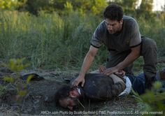 """S-1 Ep 4 """"Vatos"""". Jim (Andrew Rothenberg) and Shane Walsh (Jon Bernthal). Shane restrains Jim... Jim had been digging graves and wouldn't stop when the group asked him to."""