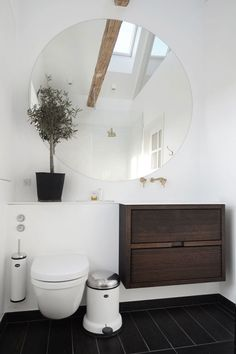 Itty Bitty Bathroom - Floating cabinet, detail in handle with small touch of brass or bare wood. Take floating cabinet countertop and extend over toilet for extra counter space ***