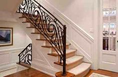 Elegant Black Iron Stair Railing Image Gallery in Staircase Traditional design ideas with Elegant area rug carpeted staircase dark wood floor french doors iron railing molding Wrought Iron Stair Railing, Staircase Handrail, Stair Railing Design, Iron Railings, Railing Ideas, Stairway Wainscoting, Balustrade Design, Iron Spindles, Iron Handrails