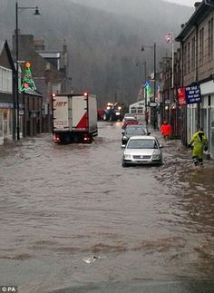 Evacuations: Firefighters have been helping police to rescue residents from a number of properties in Ballater, Scotland, after waters began to quickly rise this morning Nine Months, Britain, Street View, Weather, River, Firefighters, Banks, Darkness, Scotland