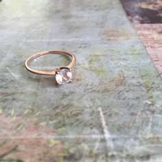 🎉HP🎉[NEW] White Topaz • 18k Rose Gold .925 Ring A beautiful + delicate White Topaz ring, size 7. 18k Rose Gold plated over genuine .925 Sterling Silver. So, so adorable. Vintage Jewelry Rings