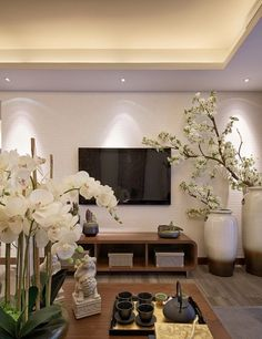 white orchids and white silk cherry blooms give a Chinese feel                                                                                                                                                                                 More