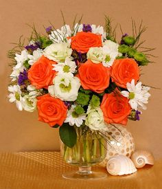 RUSTIC   Roses, Asparagus, Lisianthus, Mums & Statice  A dazzling and rustic blend of orange roses, mums, asparagus and lisianthus is an arrangement that is truly eye-catching! These flowers exude great appreciation and admiration to your loved one. Orange Roses, Spring Flowers, Asparagus, Appreciation, Rustic, Eye, Table Decorations, Home Decor, Country Primitive