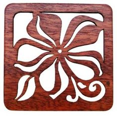 Hawaiian Laser Cut Wood Coasters. Set of 4. Drawing the essence of Hawaii's rich culture, these elegantly designed coasters will add a delicate touch to your dining and entertaining endeavors. Measure