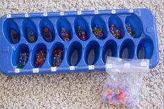 Use a regular ice cube tray labeled with numbers and include a bag of small beads/cereal.  You will need at least 136 piecces. Have your child put that amount in each ice cube space.